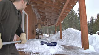 Clearing Snow From Deck After Blizzard