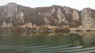 Cliffs of Mountain Along Water in Romania