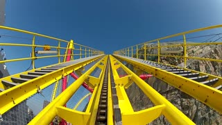 Climb Up the Initial Peak on a Yellow Roller Coaster