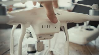 Close focus, man checks high level of freshly charged rechargeable lithium battery on drone back