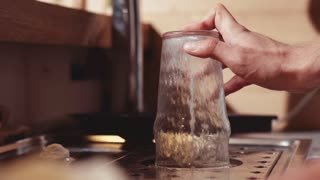 Close-up of bartender's hands cleaning a glass. Slow Motion 240 fps. Barman is working at the bar.