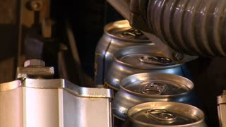 Close-up Of  Beer Cans On Assembly-line