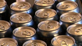 Close-up Of Beer Cans On The Assembly Line