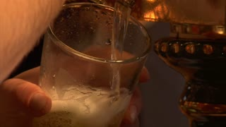 Close-up Of Beer Pouring From Tap