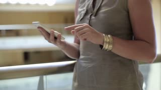 Close up of businesswoman texting message on cellphone in the office