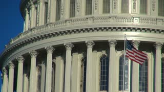 Close Up of Capitol Building with American Flag