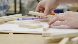 Close up of hands - student in shop class doing woodwork
