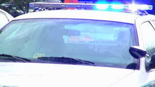 Close Up of Windshield and Flashing Lights on Cop Car