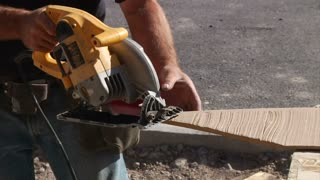Close-up On Circular Saw Cutting Wood