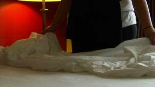 Close-up On Housekeepers Changing Hotel Bed