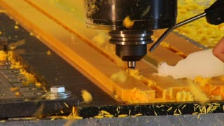 Close-up On Industrial Milling Machine Carving Plastic Track