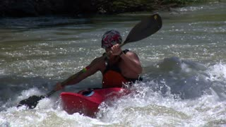Close-up On Man Paddling White-water Kayak In Slow Motion
