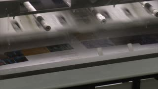 Close-up On Printed Materials And Mechanical Feeder On Printing Press