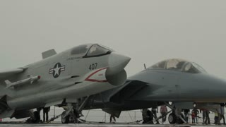Close Up On Two Fighter Jets With Tourist Visitors
