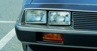 Close Up Slider Shot of Delorean Logo and Barcode License Plate 4K