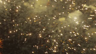 Close Up Yellow Glittery Fireworks exploding