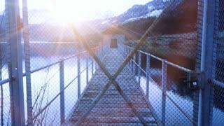closed locked door. bridge road pier. sunset dusk.