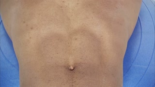 Closeup of Black Mans Abdominal Muscles