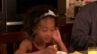 Closeup of Girl and Father Eating Breakfast