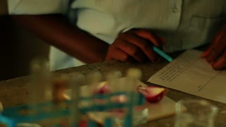 Closeup of Girl Doing Chemistry in Kenya 2