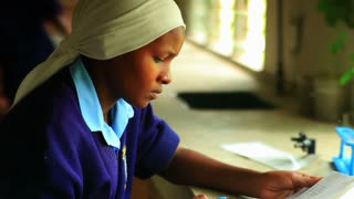 Closeup of Girl Doing Chemistry in Kenya