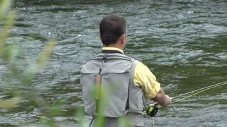 Closeup Of Man Fly Fishing in River