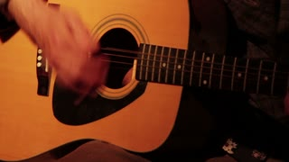 Closeup of Man Strumming Guitar 2