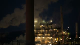 Closeup of Power Plant Smokestack at Night