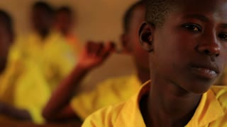 Closeup of School Boy in Kenya Classroom 2
