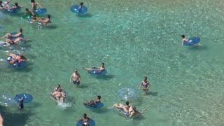 Closeup of Tubers Wading in Lazy River