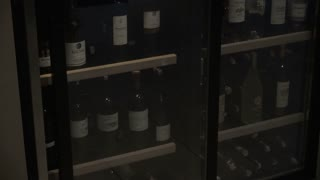 Closeup of Wine Bottles on Shelves
