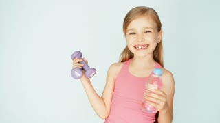 Closeup portrait girl holding dumbbell on a white background