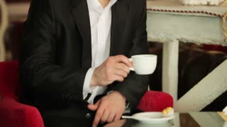 Closeup portrait of a businessman drinking coffee in a cafe