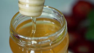 Closeup shot of honey in jar, super slow motion, shot at 240fps