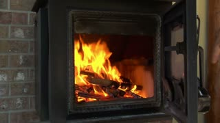 Closing And Opening Woodstove Door With Fire