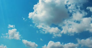 Clouds background. Blue sky time lapse. Timelapse clip of white fluffy clouds over blue sky. Timelapse of white fluffy clouds at blue sky. Nature background. Blue clouds sky. Cloudy atmosphere