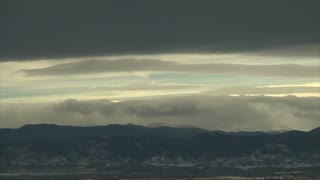Clouds Billowing Over Mountain Range