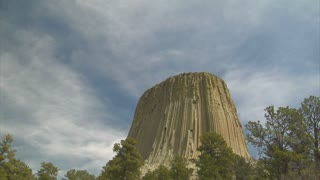 Clouds Moving Over Giant Rock Formation