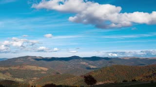 Clouds over the Forested Mountains. Time Lapse 4K