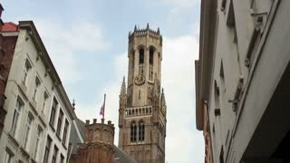 Clouds Passing Behind Tall Tower In Brugge