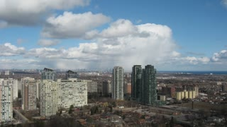 Clouds passing over Mississauga Timelapse. Time lapse of clouds passing over Mississauga, Canada on a beautiful spring day. Passing precipitation and blue skies.