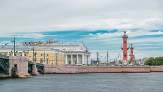 Cloudy sky over Strelka - Spit of Vasilyevsky Island with the Old Stock Exchange and Rostral Columns timelapse in Saint Petersburg, Russia