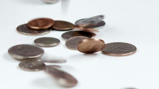 Coins Dropping onto a Surface 4