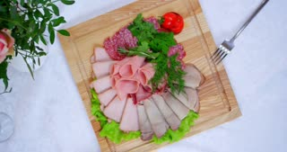 cold cuts on white tablecloths
