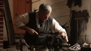 Colonial Blacksmith Filing Metal 2
