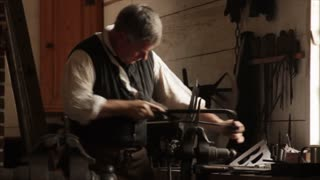 Colonial Blacksmith Filing Metal