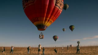 Colorful Hot Air Balloon Liftoff With Spectators Taking Photos