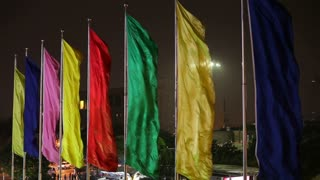 Colourful flags flying at the end of Century Avenue, Pudong, Shanghai, China, Asia