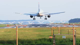 Commercial Jet Landing On Runway, Action Shot, Day