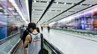 Commuters on a moving walking transiting Hong Kong Central MTR Station, Hong Kong, China, T/lapse